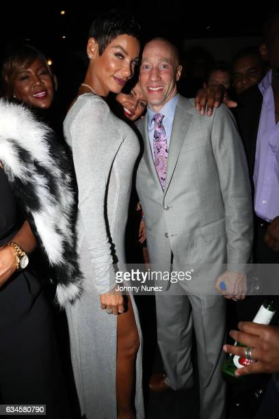 Nicole Mitchell Murphy and Ted Reid attend the Annual PreGrammy Reception hosted by Ted Reid at STK on February 9 2017 in Los Angeles California