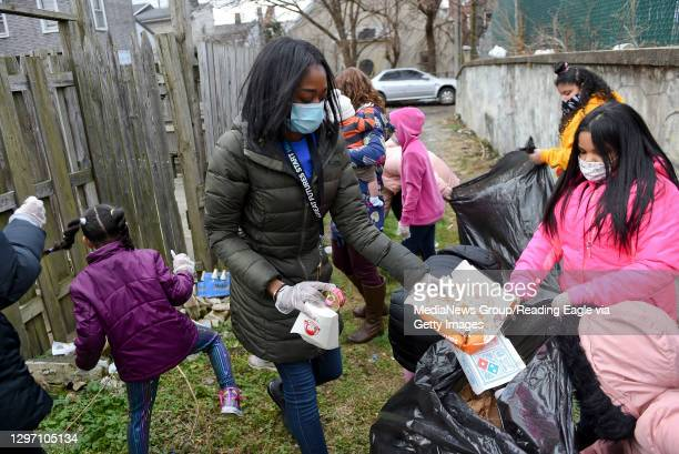 Nicole Mitchell, the Assistant Director at the Mulberry Street club puts trash in the bag. At the Olivet Boys and Girls Club Mulberry Street location...