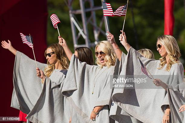 Nicole Moore , wife of US golfer Ryan Moore; and Mandy Sneaker , wife of US golfer Brandt Sneaker; cheer during the Opening Ceremony of the 41st...