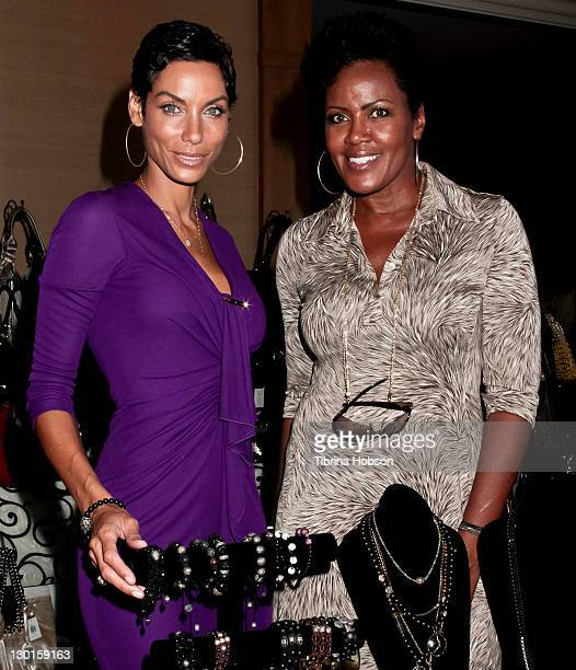 Nicole Murphy and guest attend the 2011 Starlight Children's Foundation's Design and Wine Fundraiser at Kathy Hilton's residence on October 23, 2011...