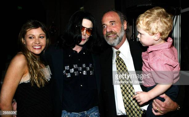 Nicole Paxson recording artist Michael Jackson Dr Allan Metzger and his grandson Kailen Metzger age two and a half attend the Light the Way for Lupus...