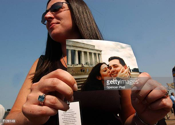 Nicole Petrocelli holds a picture of herself with her late husband Mark who was killed during the September 11 attacks on the World Trade Center...