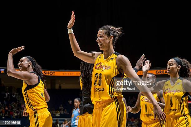 Nicole Powell Candice Wiggins and Skylar Diggins of the Tulsa Shock celebrate their victory over the Chicago Sky during the WNBA game on June 20 2013...