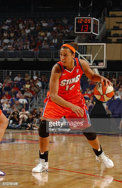 Nicole Powell of the Charlotte Sting dribbles to the basket against the Phoenix Mercury during a WNBA game played on June 11 2004 at America West...