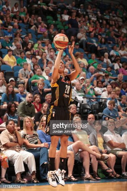 Nicole Powell of the Minnesota Lynx shoots against the Minnesota Lynx during the WNBA game on June 23 2013 at Target Center in Minneapolis Minnesota...
