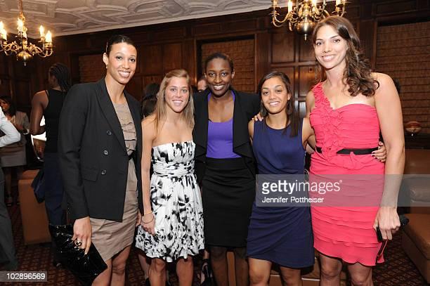 Nicole Powell of the New York Liberty Ashley Houts of the Washington Mystics Kalana Greene Leilani Mitchell and Sidney Spencer all of the Liberty...