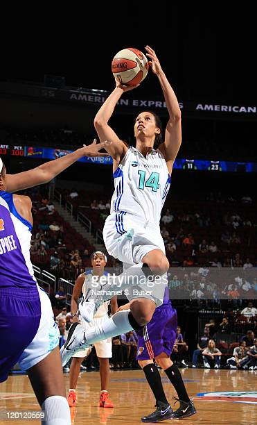 Nicole Powell of the New York Liberty shoots against the Phoenix Mercury during a game on July 30 2011 at the Prudential Center in Newark New Jersey...