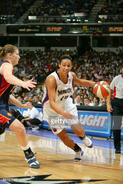 Nicole Powell of the Sacramento Monarchs drives to the basket around Lindsay Whalen of the Connecticut Sun during Game 4 of the WNBA finals on...