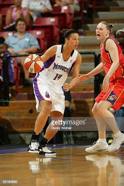 Nicole Powell of the Sacramento Monarchs moves the ball as she is covered by Penny Taylor of the Phoenix Mercury on June 10 2005 at Arco Arena in...