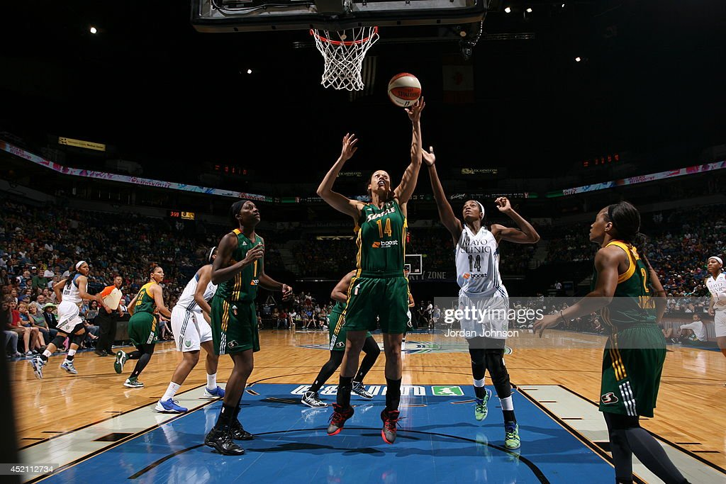 Nicole Powell #14 of the Seattle Storm goes for the shot against Devereaux Peters #14 of the Minnesota Lynx during the WNBA game on July 13, 2014 at Target Center in Minneapolis, Minnesota.