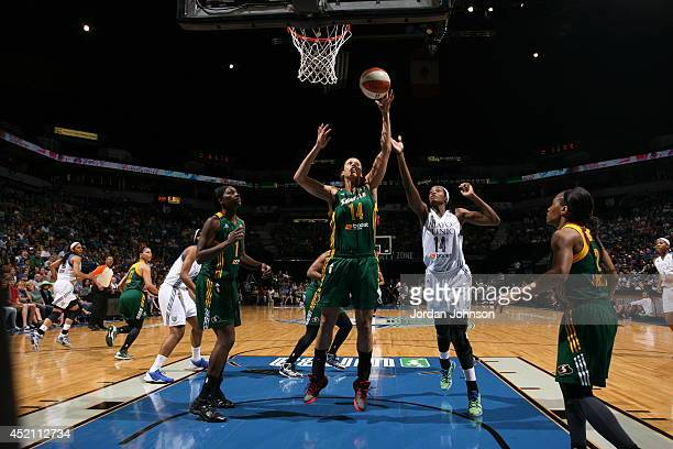 Nicole Powell of the Seattle Storm goes for the shot against Devereaux Peters of the Minnesota Lynx during the WNBA game on July 13 2014 at Target...