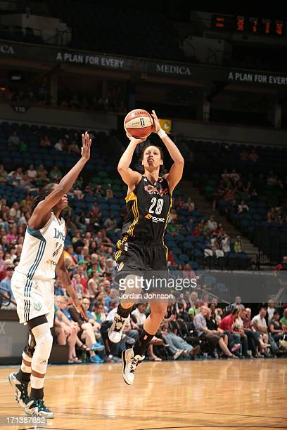 Nicole Powell of the the Tulsa Shock shoots against Devereaux Peters of the Minnesota Lynx during the WNBA game on June 23 2013 at Target Center in...