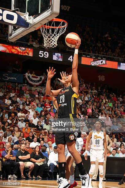 Nicole Powell of the Tulsa Shock goes up to shoot while playing in a game against the Connecticut Sun on July 2 2013 at the Mohegan Sun Arena in...