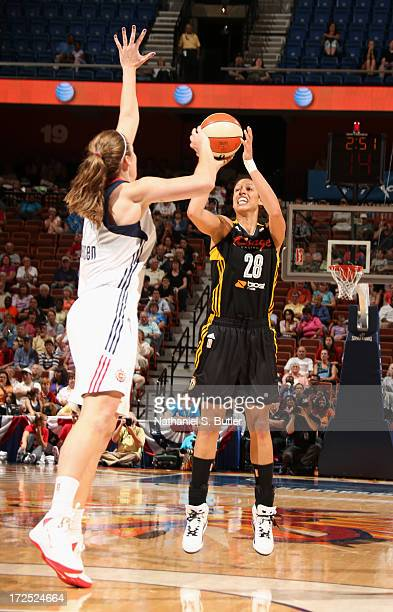 Nicole Powell of the Tulsa Shock shoots against Kayla Pedersen of the Connecticut Sun during a game on July 2 2013 at the Mohegan Sun Arena in...