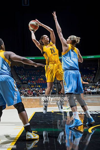 Nicole Powell of the Tulsa Shock shoots the ball against the Chicago Sky during the WNBA game on June 20 2013 at the BOK Center in Tulsa Oklahoma...