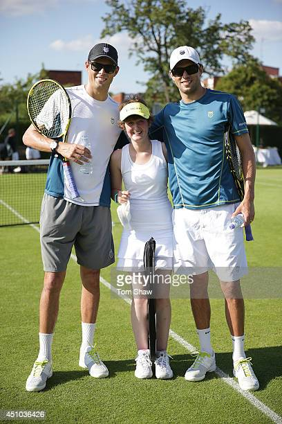 Nicole Reeve from the Starlight Children's Foundation meets Bob Bryan and Mike Bryan of the USA during the Approach London Tennis Classic at the...