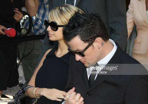 Nicole Richie and boyfriend Joel Madden leave court in Glendale California 27 July 2007 after Richie pleaded guilty to driving under the influence of...