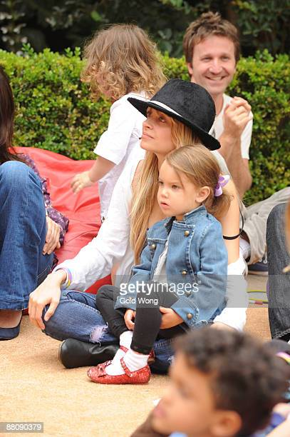Nicole Richie and friend watch a band at The 3rd Annual Kidstock Music and Arts Festival at Greystone Mansion on May 31 2009 in Beverly Hills...