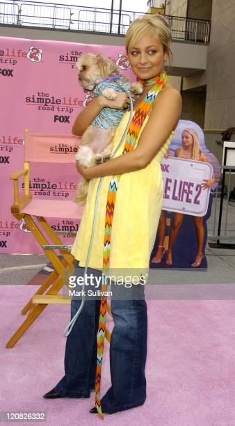 """Nicole Richie and her dog Honey Child during """"The Simple Life 2"""": Nicole Richie Hosts Dog Fashion Show at Hollywood and Highland in Hollywood,..."""