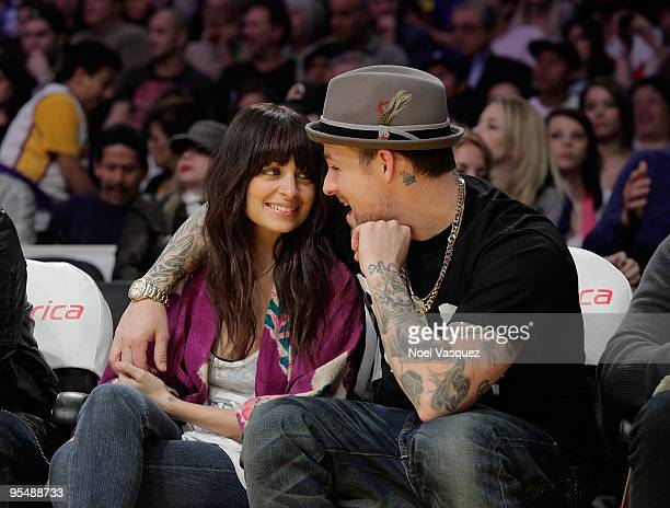 Nicole Richie and Joel Madden attend a game between the Golden State Warriors and the Los Angeles Lakers at Staples Center on December 29 2009 in Los...