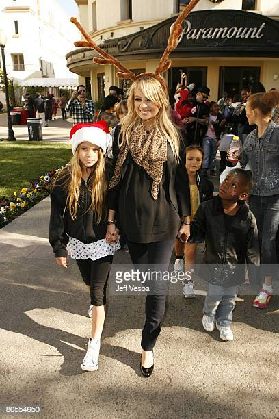 Nicole Richie and Joel Madden greet children at the Richie Madden Children's Foundation Holiday Party on December 22,2007 in Los Angeles,California....