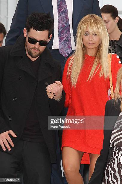 Nicole Richie and Joel Madden leave the Louis Vuitton Ready to Wear Spring / Summer 2012 show during Paris Fashion Week on October 5 2011 in Paris...