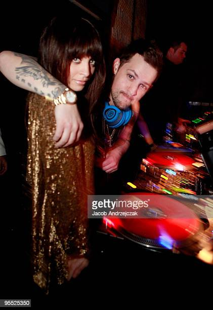 Nicole Richie and Joel Madden pose at Lavo at the Palazzo on December 31 2009 in Las Vegas Nevada
