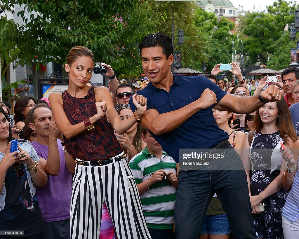 Nicole Richie dances with Mario Lopez at 'Extra' at The Grove on July 10, 2013 in Los Angeles, California.