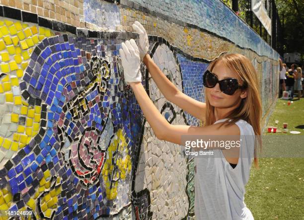 Nicole Richie helps restore CITYarts Mosiac Peace Wall during Bing and DoSomething.org's celebration of The Bing Summer of Doing at Jacob H. Schiff...