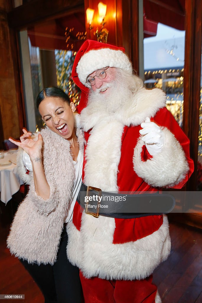 Nicole Richie poses with Santa at the Baby2Baby Holiday Event at The Grove on Wednesday, December 17, 2014 in Los Angeles, California.