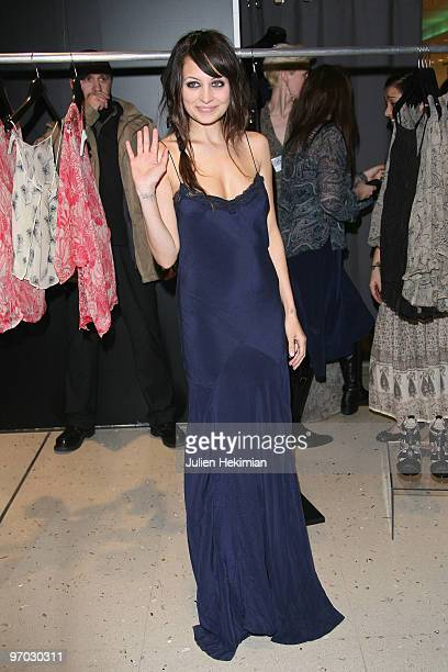 Nicole Richie show her tatoo 'Virgin' while she salutes the crowd during the launch of the 'Winter Kate' collection at Galeries Lafayette on February...