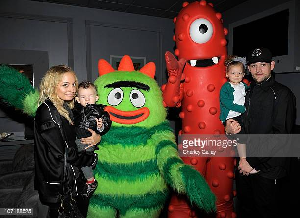 Nicole Richie, son Sparrow Madden, daughter Harlow Madden and husband musician Joel Madden pose with YO GABBA GABBA! characters backstage at YO GABBA...