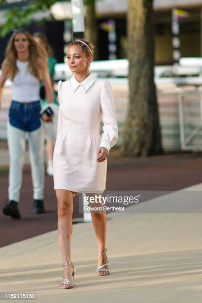 Nicole Richie wears a pale pink dress with a white collar a headband silver heels shoes outside Miu Miu Club 2020 on June 29 2019 in Paris France