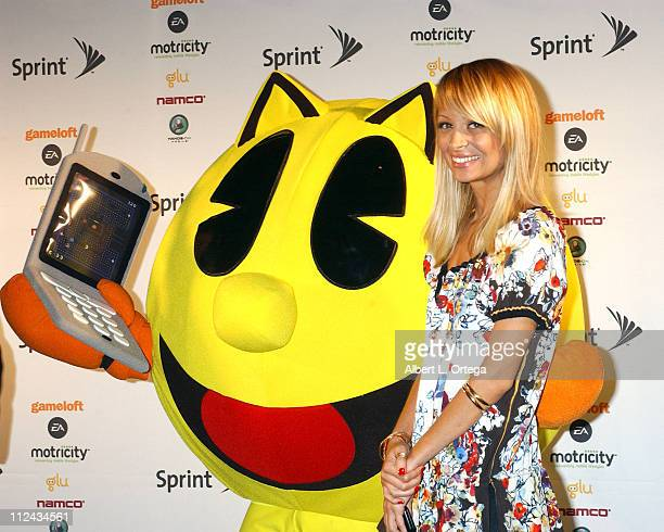 Nicole Richie with Super Pacman during 2006 E3 Convention - Day One at The Los Angeles Convention Center in Los Angeles, CA, United States.