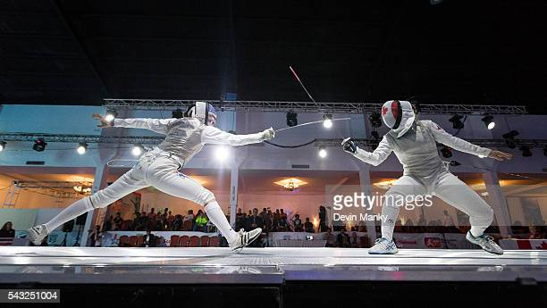 Nicole Ross of the USA lunges against Kelleigh Ryan of Canada during the gold medal match in the Team Women's Foil event Team USA would go on to win...
