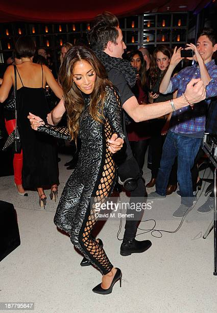 Nicole Scherzinger and Nick Grimshaw attend the first anniversary party of Sushi Samba at Sushi Samba on November 12 2013 in London England