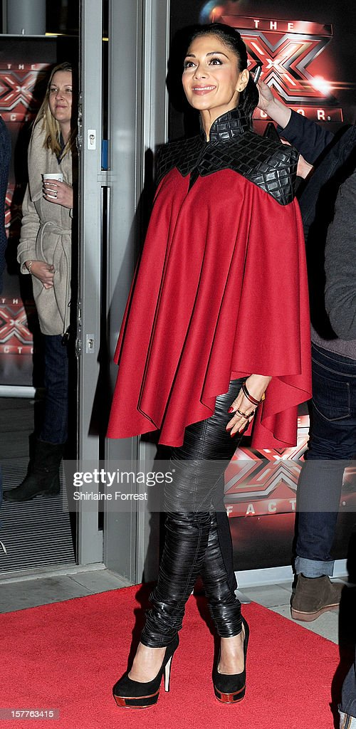Nicole Scherzinger attends a press conference ahead of the X Factor final this weekend at Manchester Conference Centre on December 6, 2012 in Manchester, England.