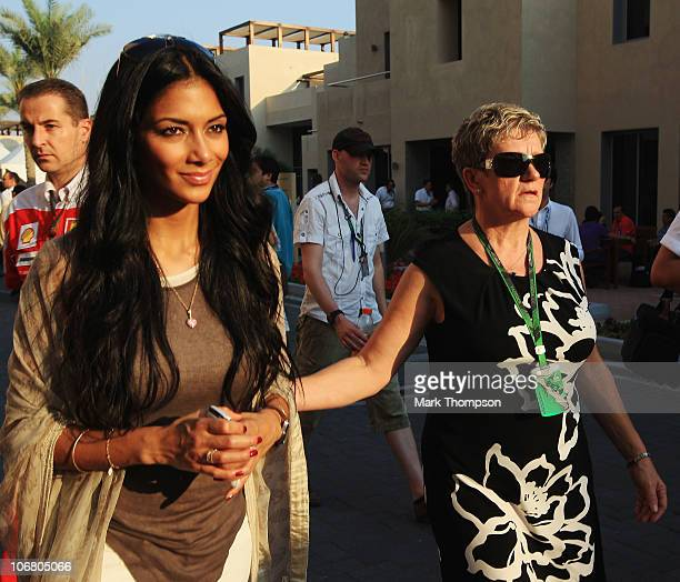 Nicole Scherzinger girlfriend of Lewis Hamilton of Great Britain and McLaren Mercedes and his mother Carmen Lockhart attend qualifying for the Abu...