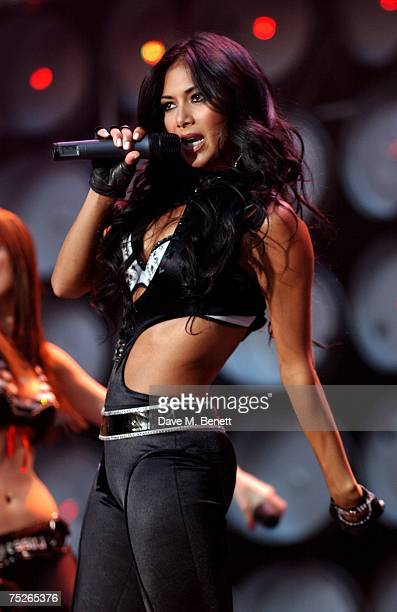 Nicole Scherzinger of the Pussycat Dolls performs on stage during the Live Earth London concert at Wembley Stadium July 7 2007 in London England Live...