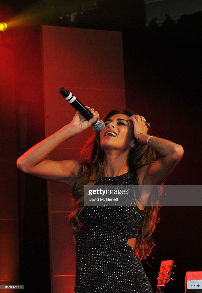 Nicole Scherzinger performs at the BBC Children in Need Gala hosted by Gary Barlow at The Grosvenor House Hotel on November 11, 2013 in London, England.