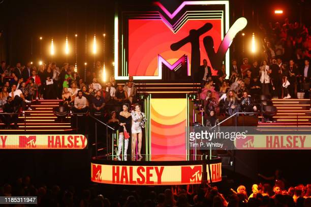 Nicole Scherzinger presents the Best Pop Award to Halsey on stage during the MTV EMAs 2019 at FIBES Conference and Exhibition Centre on November 03...