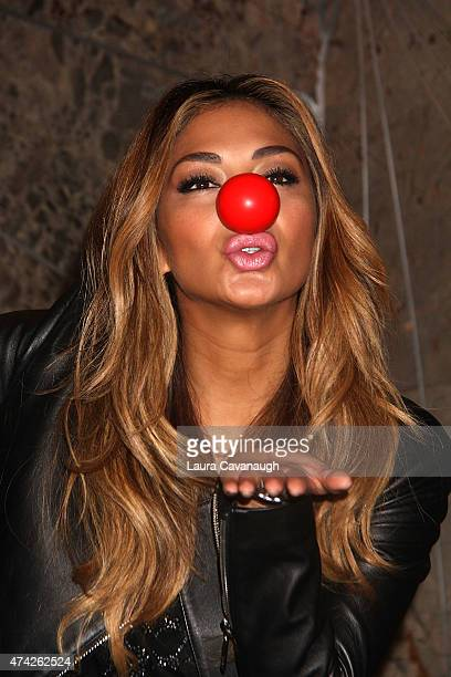 Nicole Scherzinger visits The Empire State Buidling In Celebration Of Red Nose Day USA at The Empire State Building on May 21 2015 in New York City