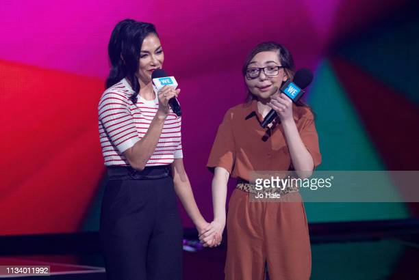 Nicole Scherzingerr and Nikki Christou speak on stage at We Day UK at SSE Arena on March 06 2019 in London England