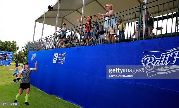 Nicole Smith interacts with the crowd on the 17th hole during the second round of the Walmart NW Arkansas Championship Presented by PG at the...