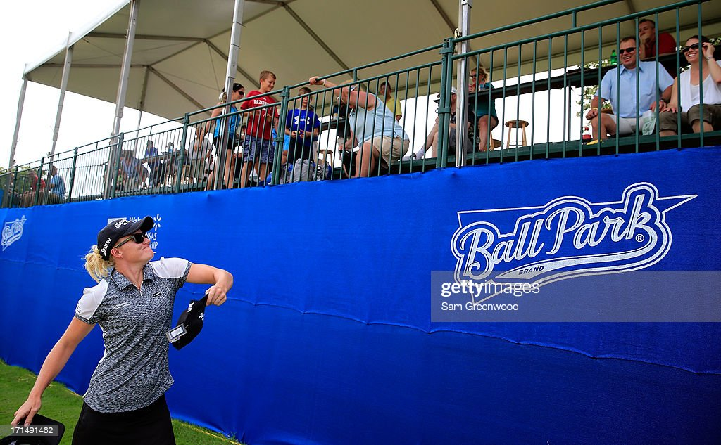 Nicole Smith interacts with the crowd on the 17th hole during the second round of the Walmart NW Arkansas Championship Presented by P&G at the Pinnacle Hills Country Club on June 22, 2013 in Rogers, Arkansas.