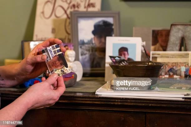 Nicole SmithHolt holds a picture of her son on January 15 2020 in Richfield Minnesota It's the wealthiest country on the planet but the sometimes...