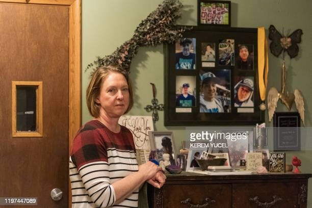 Nicole SmithHolt poses in front of photos of her son on January 15 in Richfield Minnesota It's the wealthiest country on the planet but the sometimes...