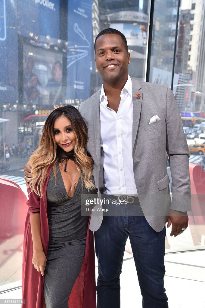 Nicole 'Snooki' Polizzi and AJ Calloway during a taping of 'Extra' at H&M Times Square on August 22, 2017 in New York City.
