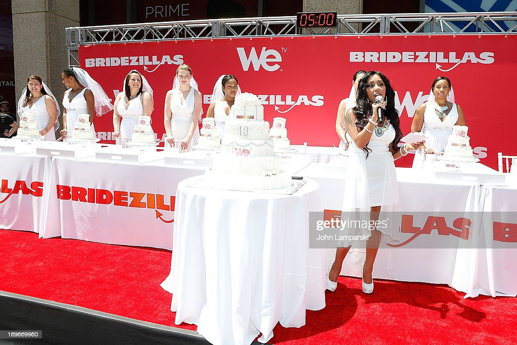 Nicole 'Snooki ' Polizzi and contest participants attend the 'Bridezillas' Cake Eating Competition & WE TV's 10th Anniversary Celebration at Madison Square Garden on May 30, 2013 in New York City.