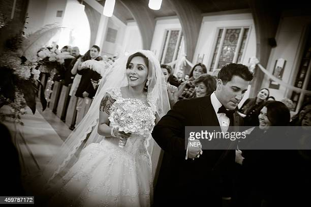 Nicole Snooki Polizzi and Jionni LaValle are seen druing their wedding at St Rose Of Lima on November 29 2014 in East Hanover New Jersey Dress by Eve...